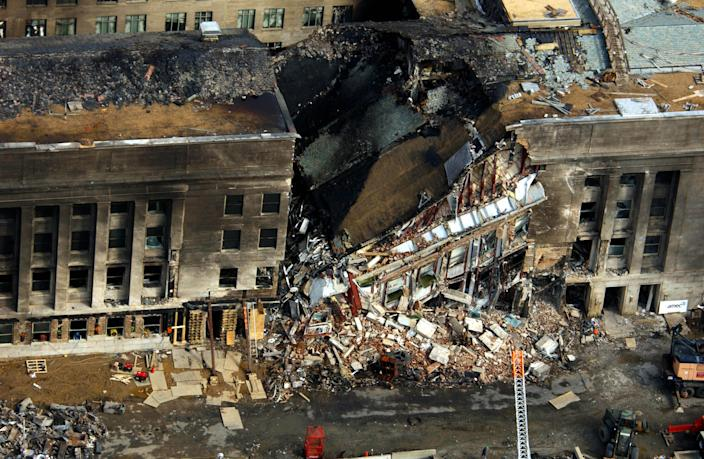 Did Pentagon surveillance tapes showing the impact of Flight 77 ever surface?<br><br>In 2006, three security camera videos were released in response to a December 2004 <span>Freedom of Information Act lawsuit. However, some theorists still argue that the blurry images are inconclusive and that the</span> FBI is withholding at least another 84 surveillance tapes.<br><br>Photo: U.S. Department of Defense handout photo dated September 14, 2001 shows an aerial view of the destruction caused when a hijacked American Airlines flight slammed into the Pentagon on September, 11, 2001 in Arlington, Virginia. (REUTERS/DoD/Tech. Sgt. Cedric H. Rudisill/Handout)