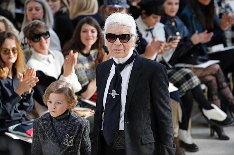 German designer Karl Lagerfeld acknowledges the audience at his Paris fashion week show on March 8, 2016