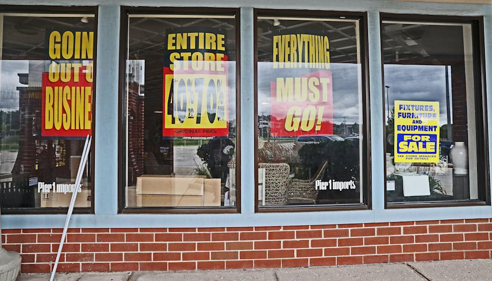 Signs in the windows of Pier 1 at Brookfield Fashion Center, 16720 W. Blue Mound Road, announce the store is going out of business. The pandemic has been especially harsh on the retail industry.