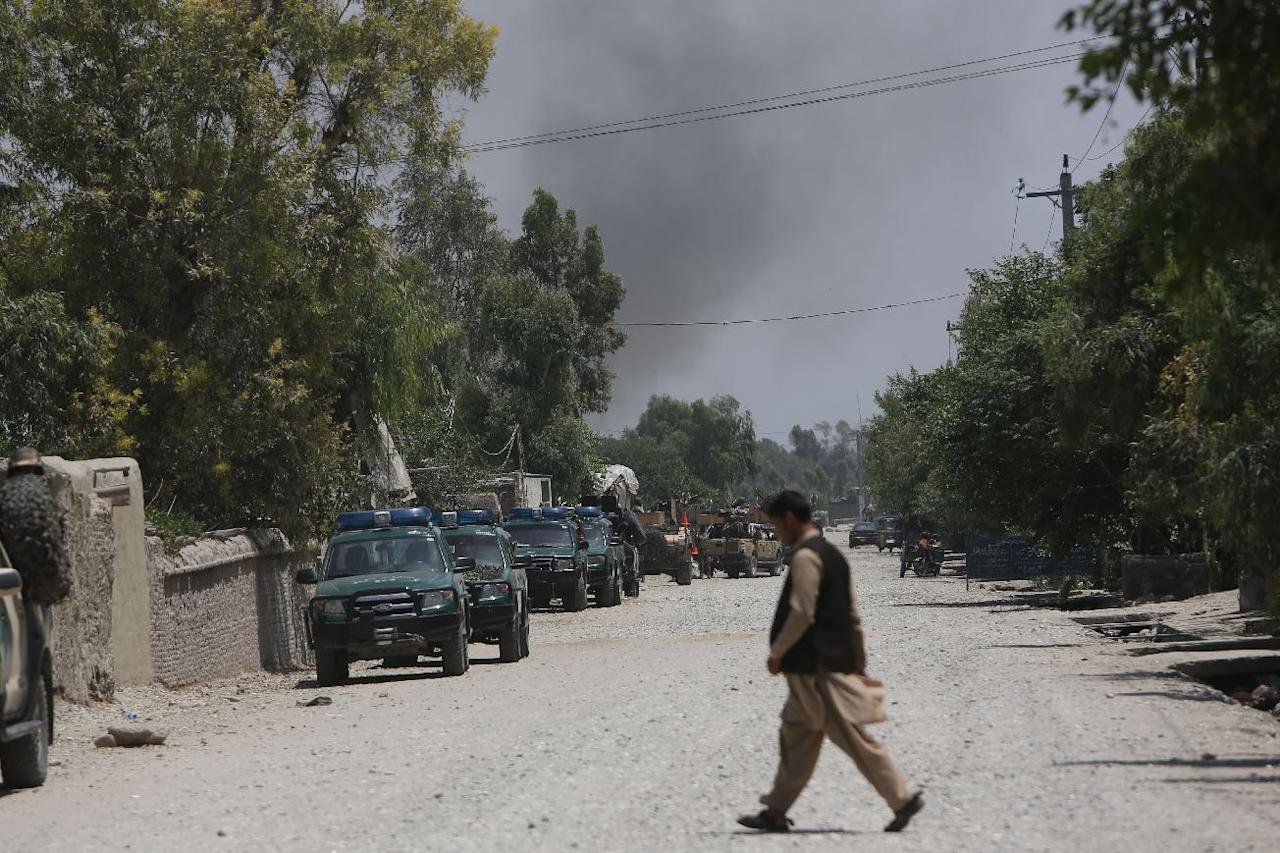 Smoke billows from a building after Taliban fighters stormed a government building killing several police guards, in Jalalabad, east of Kabul, Afghanistan, May 12, 2014. A wave of attacks marking the start of the insurgents' annual spring offensive also included an attack on a police checkpoint in the Taliban heartland in southern Helmand province that killed many policemen. The Taliban offensive comes at a sensitive time this year, against the backdrop of the country's presidential election. Militants have also stepped up terror attacks to sow insecurity and weaken the government as international forces prepare to withdraw by the end of this year. (AP Photo/Rahmat Gul)