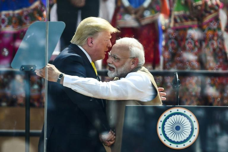 US President Donald Trump shakes hands with India's Prime Minister Narendra Modi, but behind the bonhomie and photo opportunities a comprehensive trade deal between their two nations looks remote (AFP Photo/Money SHARMA)