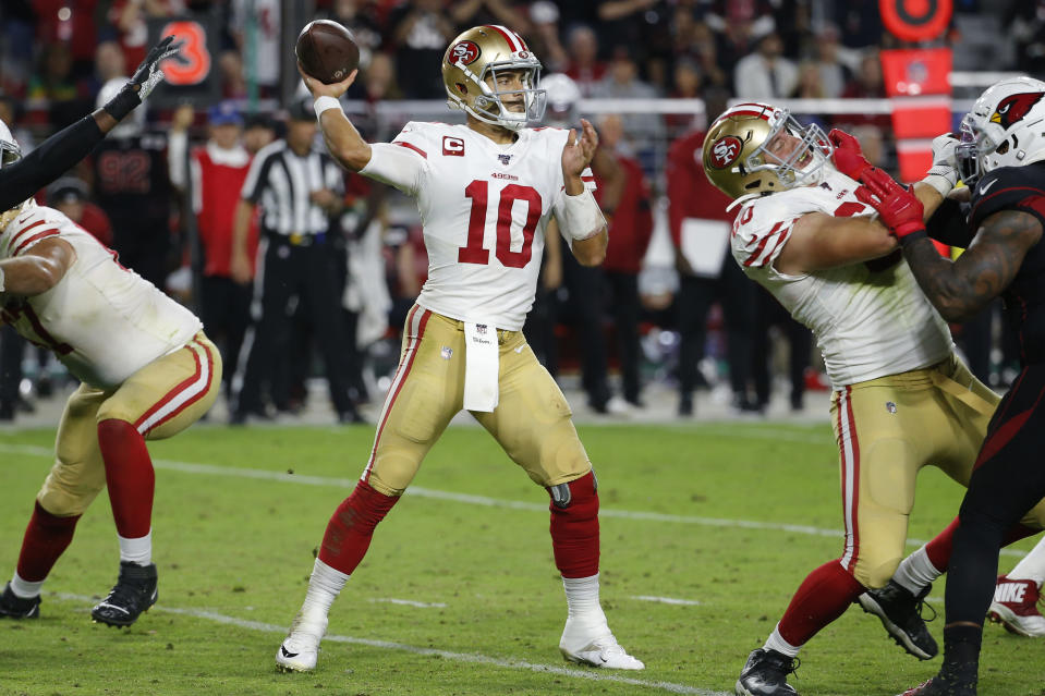 San Francisco 49ers quarterback Jimmy Garoppolo (10) throws against the Arizona Cardinals during the second half of an NFL football game, Thursday, Oct. 31, 2019, in Glendale, Ariz. (AP Photo/Rick Scuteri)