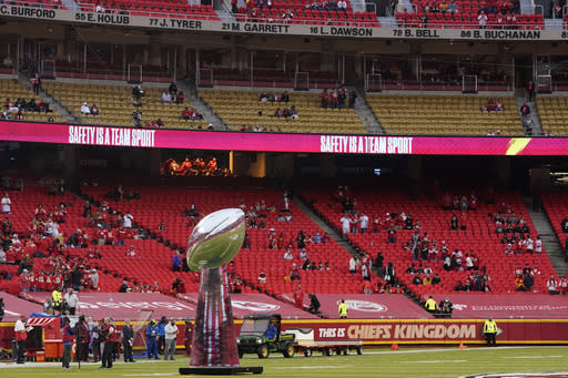A model of the Super Bowl trophy stands on the field before an NFL football game between the Kansas City Chiefs and the Houston Texans Thursday, Sept. 10, 2020, in Kansas City, Mo. (AP Photo/Jeff Roberson)
