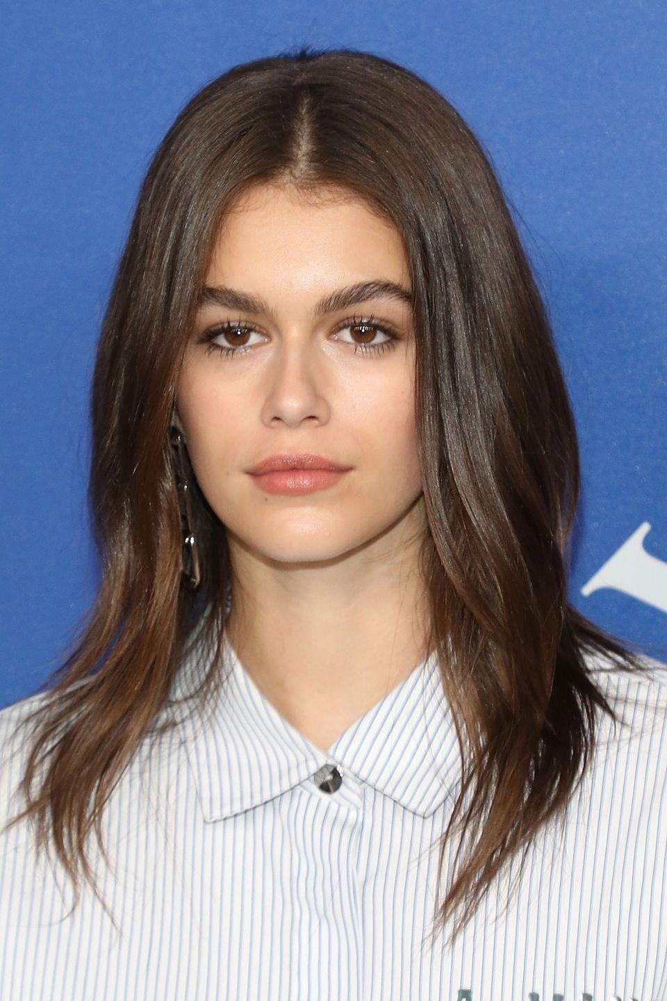 """<p>While face-shaping layers like those cut into Kaia Gerber's hair are mainly the work of a <a href=""""https://www.harpersbazaar.com/uk/beauty/spas-salons/g22469/best-hair-salons/"""" rel=""""nofollow noopener"""" target=""""_blank"""" data-ylk=""""slk:good hairdresser"""" class=""""link rapid-noclick-resp"""">good hairdresser</a>, you can enhance them when straightening your hair by making your hair flick-out at the ends.</p>"""