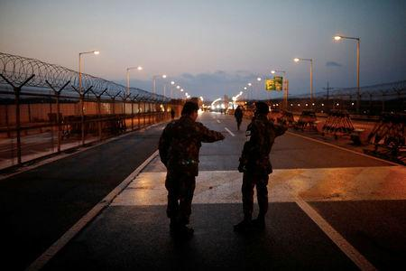 South Korean soldiers stand guard at a checkpoint on the Grand Unification Bridge that leads to the truce village of Panmunjom