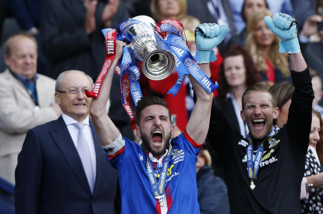 "Football - Falkirk v Inverness Caledonian Thistle - William Hill Scottish FA Cup Final - Hampden Park, Glasgow, Scotland - 30/5/15 Inverness Caledonian Thistle's Graeme Shinnie lifts the trophy after winning the William Hill Scottish FA Cup Final Reuters / Russell Cheyne Livepic EDITORIAL USE ONLY. No use with unauthorized audio, video, data, fixture lists, club/league logos or ""live"" services. Online in-match use limited to 45 images, no video emulation. No use in betting, games or single club/league/player publications. Please contact your account representative for further details."
