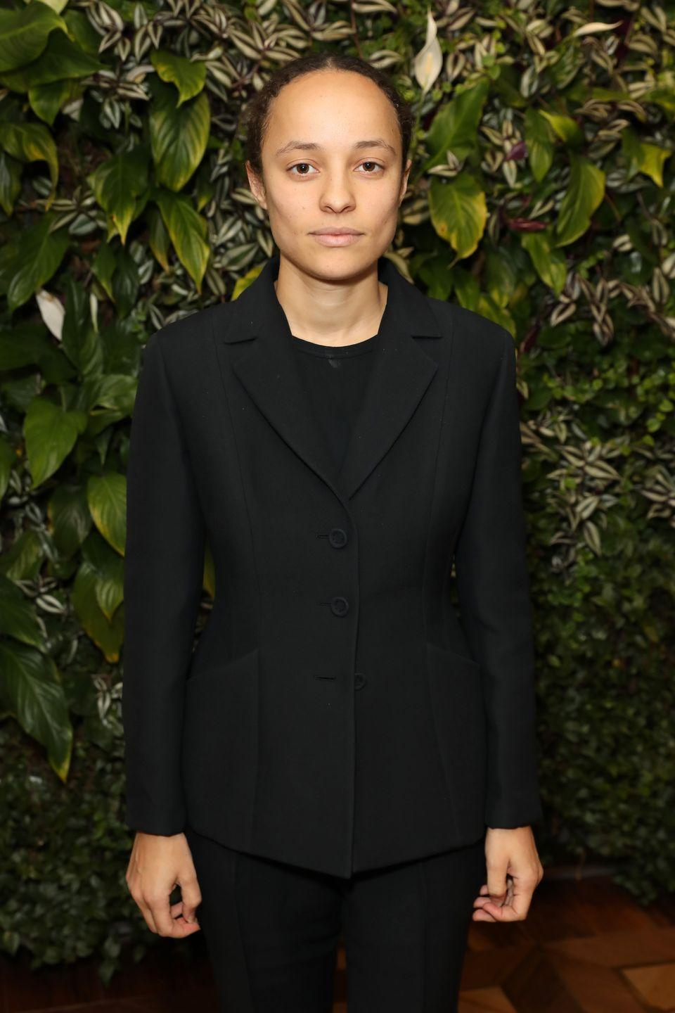 <p><strong>Brand:</strong> Wales Bonner</p><p>Launched in 2014, her eponymous label started as a menswear brand and later ventured into womenswear. The clothing is inspired by European and African history, and the tailoring is basically PERFECTION. (As you can probably tell from her impeccable black blazer in this shot.) </p>