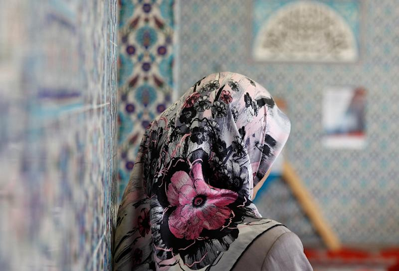 The EU's top court has ruled that European companies can ban employees from wearing religious or political symbols including the Islamic headscarf (AFP Photo/Axel HEIMKEN)