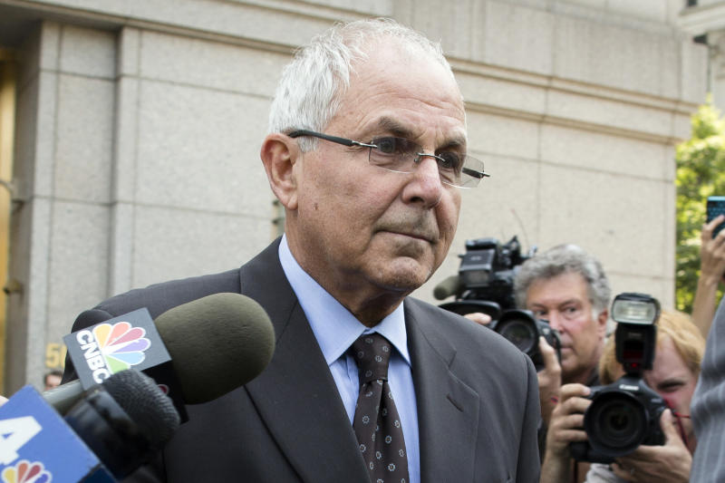 Peter Madoff leaves Federal Court on Friday, June 29, 2012 in New York after pleading guilty to criminal charges. Peter Madoff, the younger brother and business partner of disgraced financier Bernard Madoff pleaded guilty Friday to charges he doctored documents, but insisted he knew nothing about his brother's historic Ponzi scheme. Madoff, 66, entered the plea in a deal that permits him to remain free on $5 million bail pending his Oct. 4 sentencing.  (AP Photo/John Minchillo)