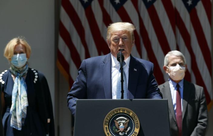 """<span class=""""caption"""">Trump with two of his top health advisers in May. </span> <span class=""""attribution""""><span class=""""source"""">AP Photo/Alex Brandon</span></span>"""