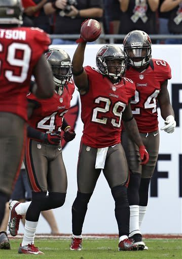 Tampa Bay Buccaneers cornerback Leonard Johnson (29) celebrates with free safety Ahmad Black (43) and strong safety Mark Barron (24) after returning a fourth-quarter interception from San Diego Chargers quarterback Philip Rivers for a touchdown during an NFL football game on Sunday, Nov. 11, 2012, in Tampa, Fla. (AP Photo/Chris O'Meara)