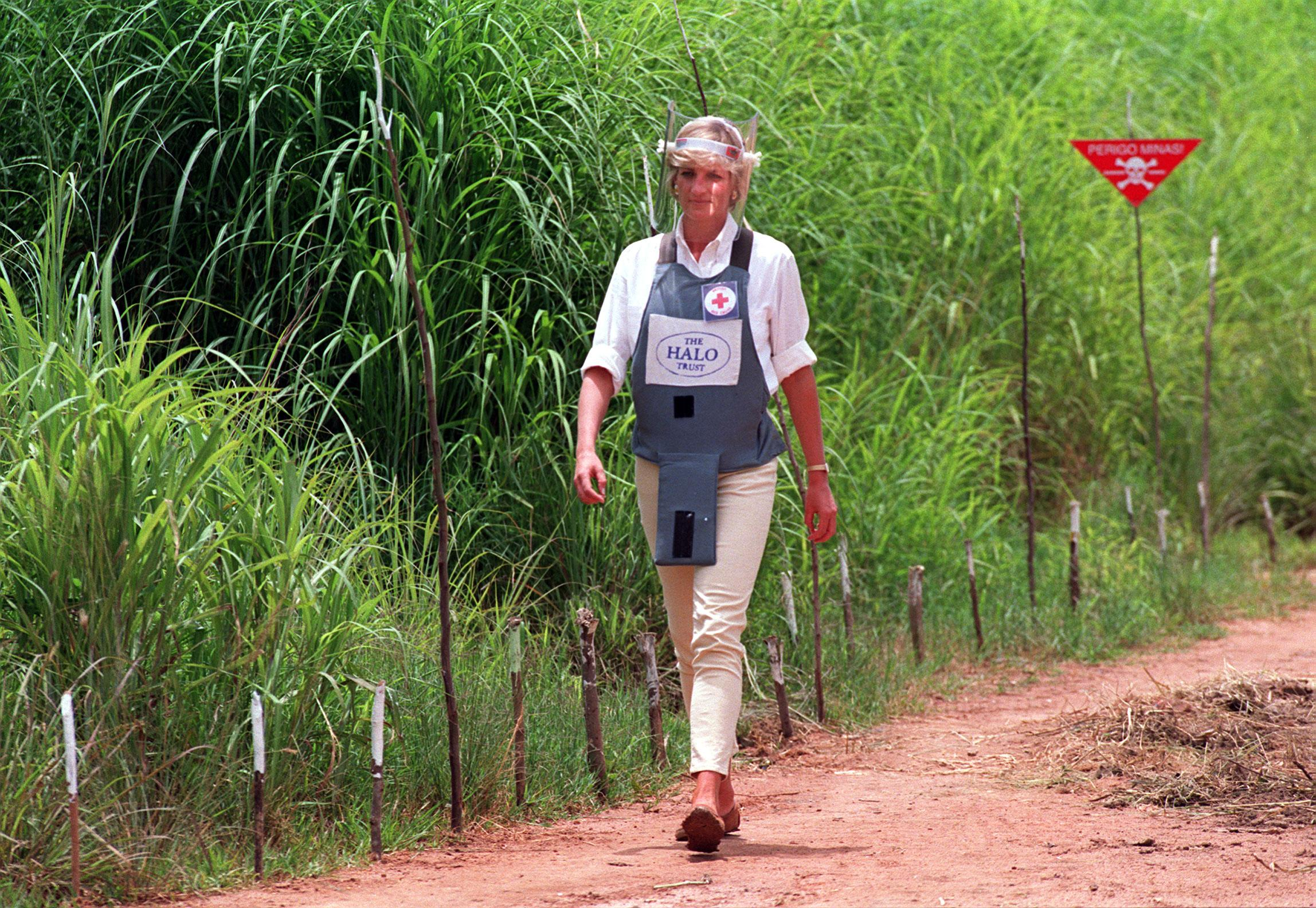 File photo dated 15/01/97 of Diana, Princess of Wales wearing a bombproof visor during her visit to a minefield in Huambo, in Angola. The Duke of Sussex has donned body armour and a protective visor to walk through a partially cleared minefield during a visit to the Halo Trust in Dirico, Angola, in scenes reminiscent of his mother Diana, on day five of the royal tour of Africa. [Photo: PA]