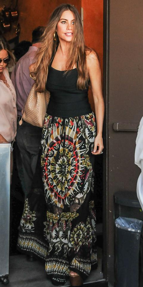 "<p>The <em>Modern Family</em> actress proved the power of the maxi skirt in a floor-grazing patterned sheath (shop a similar look <a rel=""nofollow"" href=""https://www.farfetch.com/shopping/women/alberta-ferretti-stampa-printed-pleated-chiffon-skirt-item-12170087.aspx"">here</a>), platform sandals, and a simple black tank. </p>"