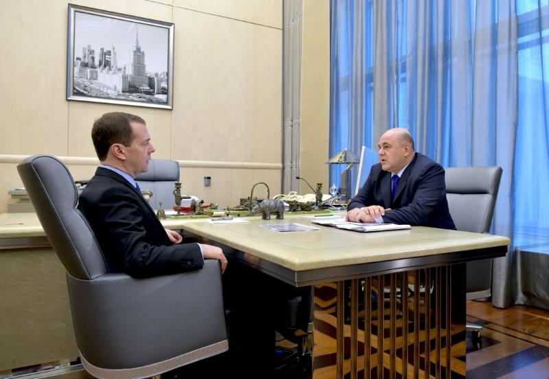 Russian Prime Minister Medvedev attends a meeting with head of the Federal Taxation Service Mishustin in Moscow