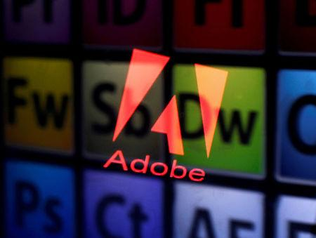 FILE PHOTO: An Adobe logo and Adobe products are seen reflected on a monitor display and an iPad screen, in this picture illustration July 8, 2013.     REUTERS/Dado Ruvic/Illustration/File Photo