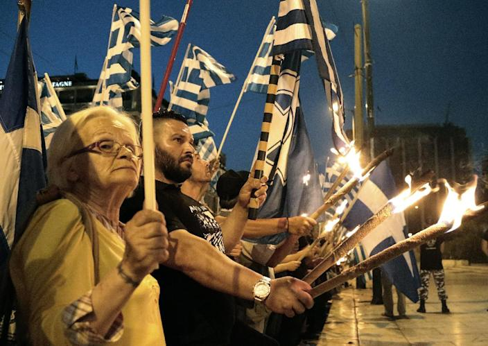 Members and supporters of the extreme right party Golden Dawn march in central Athens on Wednesday May 29, 2013, during a rally marking the anniversary of the fall of Constantinople to the Ottoman Empire in 1453. Parties in Greece's coalition government this week refused to reach agreement on new legislation aimed at curbing racial incitement and growing violence against non-European immigrants, drawing criticism from human rights groups and international Jewish organisations. (AP Photo/Dimitri Messinis)