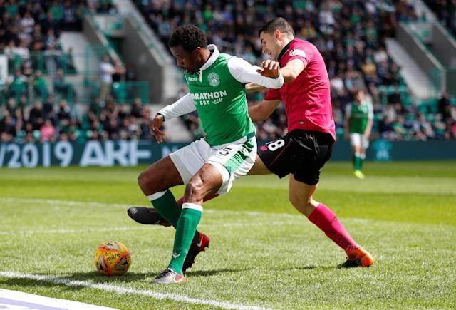 Soccer Football - Scottish Premiership - Hibernian v Celtic - Easter Road, Edinburgh, Britain - April 21, 2018 Hibernian's Efe Ambrose in action with Celtic's Tom Rogic REUTERS/Russell Cheyne