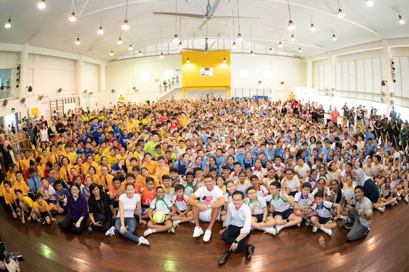Football superstar Cristiano Ronaldo taking a group photo with the schoolchildren during his visit of Yumin Primary School. (PHOTO: Singapore Olympic Foundation-Peter Lim Scholarship)