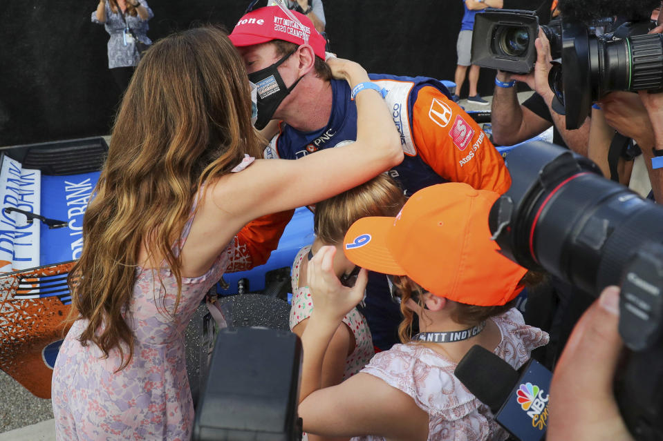 Scott Dixon kisses his wife Emma Davies after winning the NTT IndyCar Series Championship following an IndyCar auto race Sunday, Oct. 25, 2020, in St. Petersburg, Fla. (AP Photo/Mike Carlson)