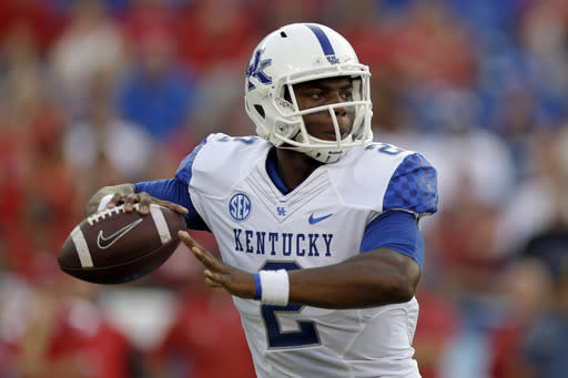 Kentucky quarterback Jalen Whitlow passes against Western Kentucky in the first quarter of an NCAA college football game on Saturday, Aug. 31, 2013, in Nashville, Tenn. (AP Photo/Mark Humphrey)