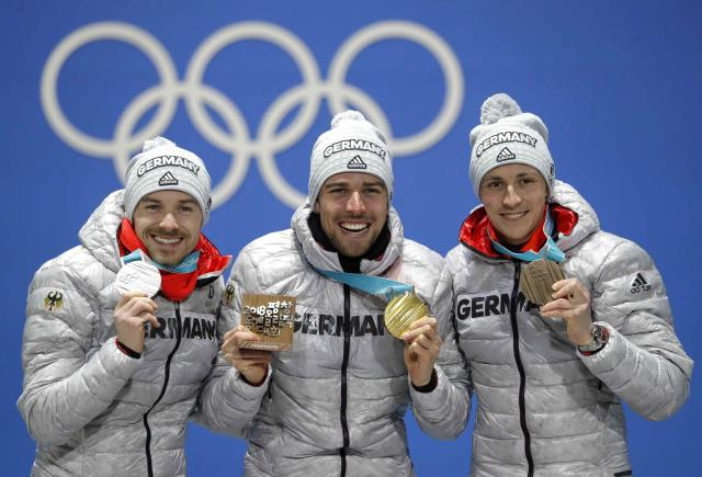 Medals Ceremony - Nordic Combined Events - Pyeongchang 2018 Winter Olympics - Men's Individual 10 km - Medals Plaza - Pyeongchang, South Korea - February 21, 2018 - Gold medalist Johannes Rydzek of Germany, silver medalist Fabian Riessle of Germany and bronze medalist Eric Frenzel of Germany on the podium. REUTERS/Eric Gaillard