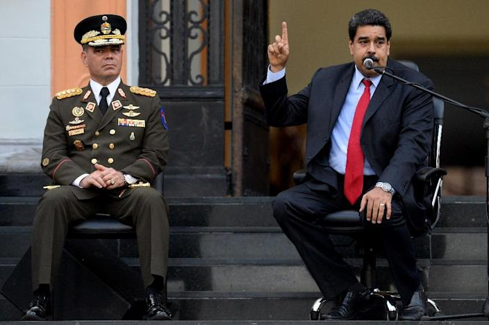 Venezuelan President Nicolas Maduro (R), next to Defence Minister Padrino Lopez. has given his military sweeping powers over food production and distribution (AFP Photo/Federico Parra)