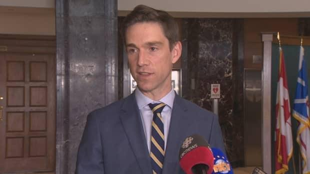 Justice Minister John Hogan speaks with reporters at Confederation Building in St. John's on Wednesday afternoon. (Mark Quinn/CBC - image credit)