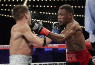 Daniel Jacobs, right, punches Ukraine's Sergiy Derevyanchenko during the ninth round of a IBF middleweight championship match Saturday, Oct. 27, 2018, in New York. Jacobs won the fight. (AP Photo/Frank Franklin II)