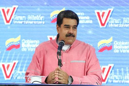 Venezuela's President Nicolas Maduro takes part in a broadcast regarding the government housing programs in Caracas