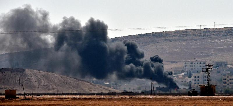 Smoke rises from the Syrian town of Ain al-Arab, known as Kobane by the Kurds, on October 6, 2014