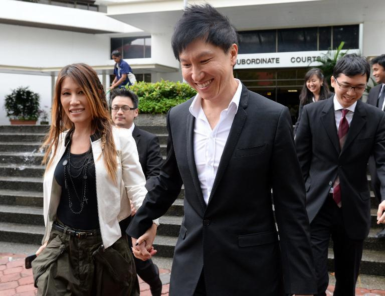 City Harvest Church founder Kong Hee and his pop-singer wife Ho Yeow Sun leave court in Singapore during his fraud trial on September 9, 2013