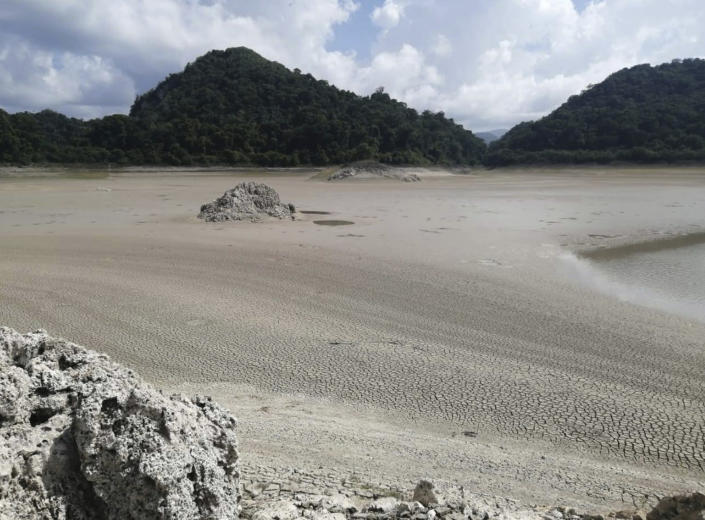In this photo provided by Mexico's National Commission for Protected Nature Areas, cracked mud is seen in the drying lake bed of the Metzabok Lagoon, in the Lacandon jungle of Chiapas State in southern Mexico, in the first half of August, 2019. During the month of August, the Metzabok lake, which normally covers 220 acres (89 hectares), dried up completely, leaving cracked mud where the surrounding jungle used to reflect in the translucent waters and Lacandon Indians traveled by canoe.(CONANP via AP)