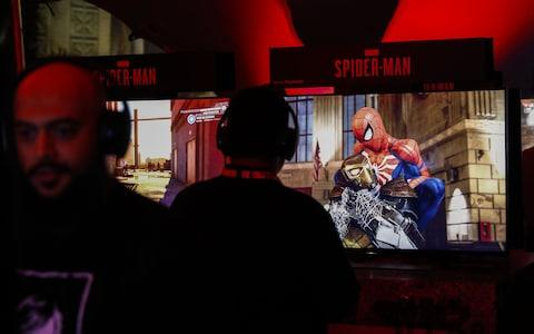 An attendee plays the Spider-Man video game during the Sony Corp. Playstation event - Credit: Bloomberg