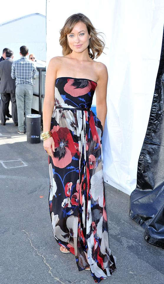 Olivia Wilde embraced the beachy SoCal vibe of the Indie Spirit Awards by sporting a flowing strapless gown, which could easily double as a swimsuit cover up.