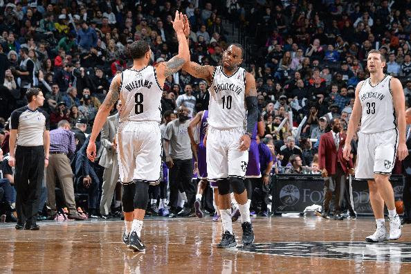 BROOKLYN, NY - MARCH 9: Deron Williams #8 and Marcus Thornton #10 of the Brooklyn Nets high-five on court during their game against the Sacramento Kings on March 9, 2014 at the Barclays Center in Brooklyn, New York. (Photo by Jesse D. Garrabrant/NBAE via Getty Images)