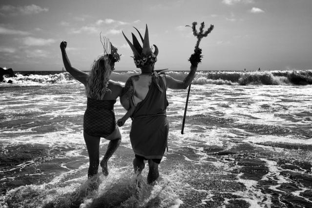 <p>King and Queen Neptune frolic in the Pacific Ocean waters, celebrating the start of summer with the yearly Neptune Parade. Today's incarnation of the Neptune Parade is inspired by the Venice Mardi Gras, celebrated for the first time in August 1935 with three days of parades and festivities. €(© Dotan Saguy) </p>
