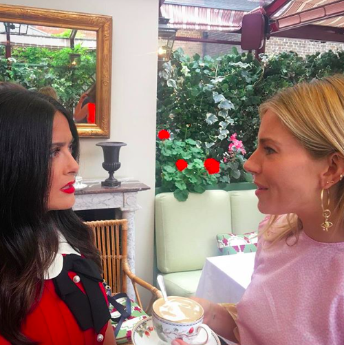 """<p>Meeting of the moms! Hayek and friend Sienna Miller got together for some coffee talk and a good cause. """"Two mothers having a cuppa and planning the @mothers2mothers event that we are cohosting with #Gucci in November,"""" she wrote. Mothers2Mothers is an international nonprofit organization dedicated to preventing mother-to-child transmission of HIV. (Photo: <a rel=""""nofollow"""" href=""""https://www.instagram.com/p/BYxs5JXBHeS/?taken-by=salmahayek"""">Salma Hayek via Instagram</a>) </p>"""