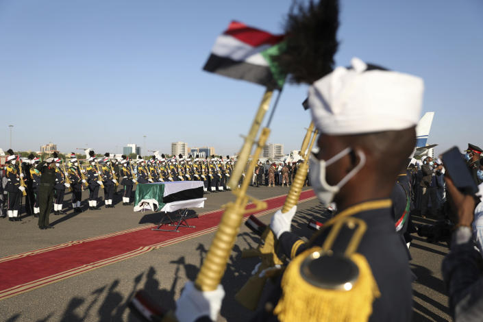Body of former Sudan's prime minster Sadiq al-Mahdi arrives to Khartoum, Sudan, Friday, Nov. 27, 2020. Al-Mahdi, Sudan's last democratically elected prime minister and leader of the country's largest political party, has died of COVID-19 in a hospital in the United Arab Emirates (AP Photo / Marwan Ali)