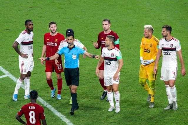 Qatari referee Abdulrahman al-Jassim gave Liverpool a penalty in injury time of the Club World Cup final against Flamengo before changing his decision following a VAR review (AFP Photo/Mustafa ABUMUNES)
