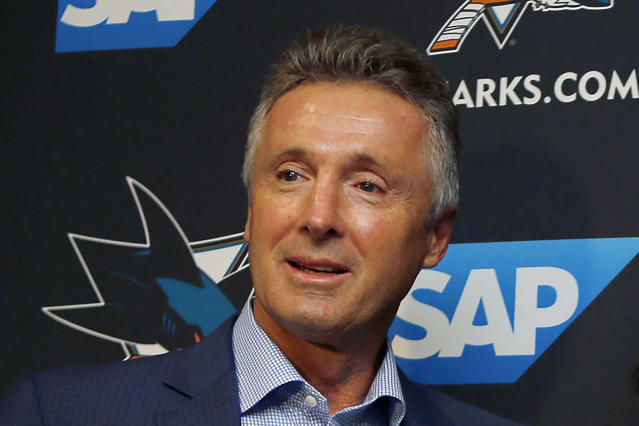 FILE - In this Sept. 19, 2018, file photo, San Jose Sharks general manager Doug Wilson is shown during a news conference in San Jose, Calif. Wilson has been elected to the Hockey Hall of Fame's class of 2020. (AP Photo/Josie Lepe, File)