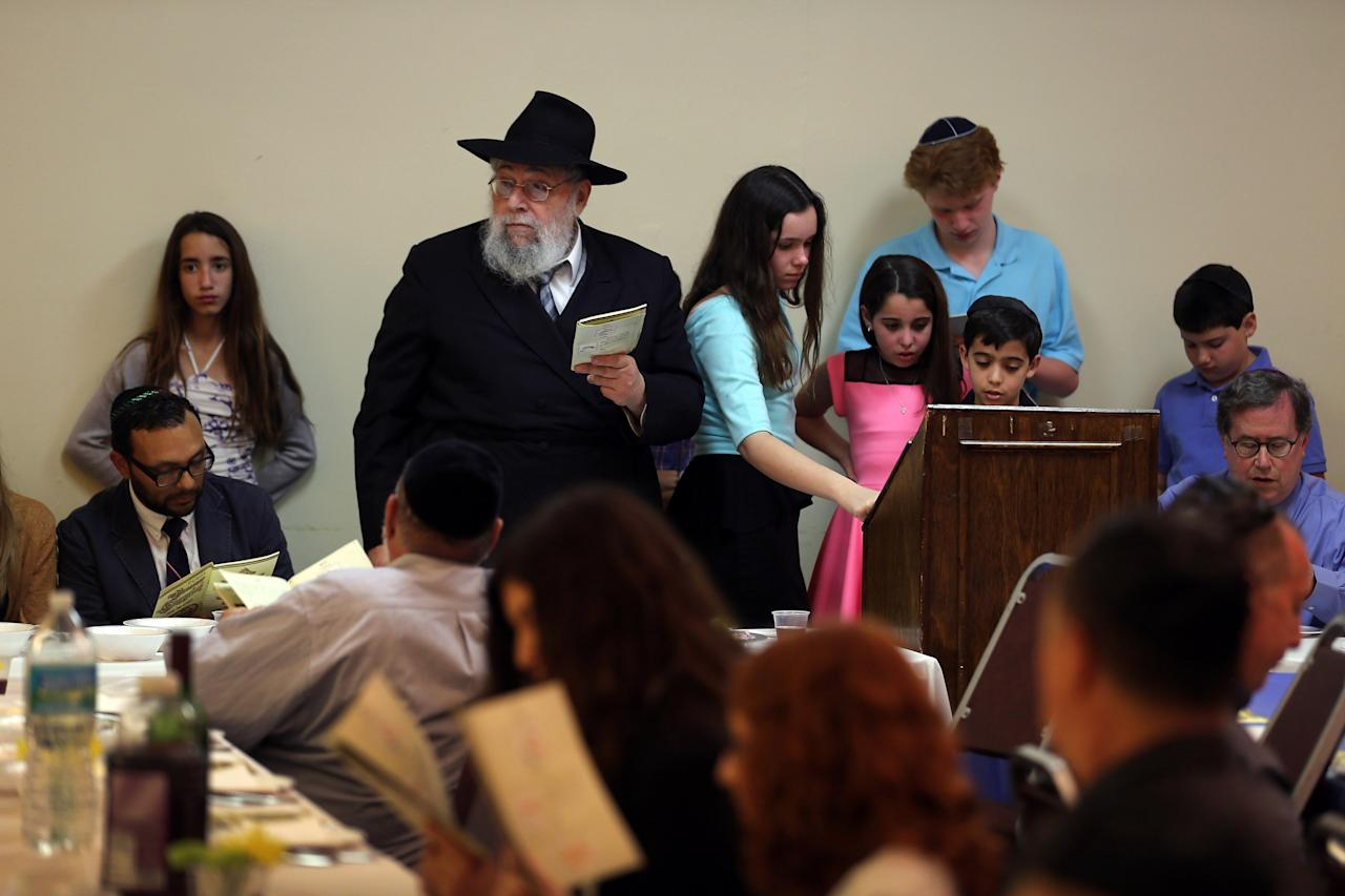 MIAMI BEACH, FL - MARCH 25:  Rabbi Efraim Katz leads a community Passover Seder at Beth Israel synagogue  on March 25, 2013 in Miami Beach, Florida. The community Passover Seder that served around 150 people has been held for the past 30 years and is welcome to anyone in the community that wants to commemorate the emancipation of the Israelites from slavery in ancient Egypt.  (Photo by Joe Raedle/Getty Images)