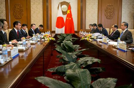 Japanese Foreign Minister Taro Kono talks during a meeting with Chinese Foreign Minister Wang Yi at the Diaoyutai State Guesthouse in Beijing