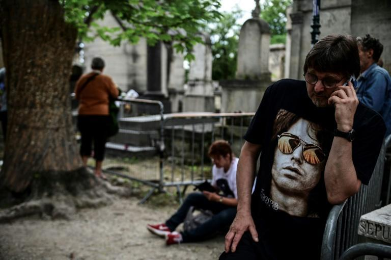 Fans of Jim Morrison gathered at his tomb to mark 50 years since his death in the French capital