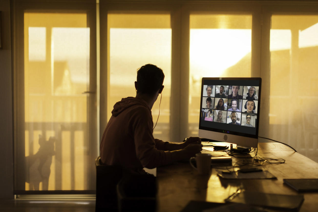 A young person at his computer