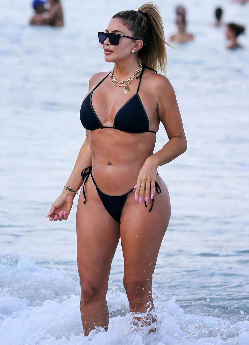 <p>Larsa Pippen takes a dip at the beach in Miami on Sunday.</p>