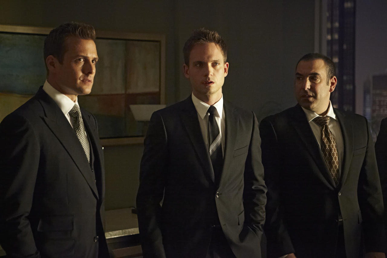 "Gabriel Macht as Harvey Specter, Patrick J. Adams as Mike Ross, and Rick Hoffman as Louis Litt in the ""Suits"" Season 3 Premiere, ""The Arrangement."""