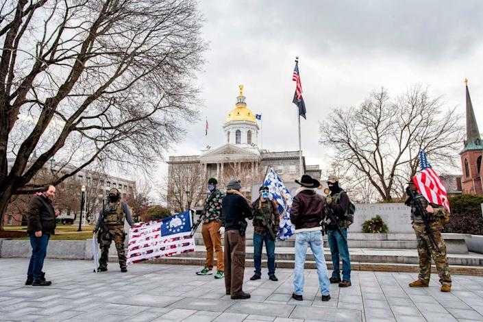 Armed far-right militia members gathered at the statehouse in Concord, New Hampshire, on Sunday. (AFP via Getty Images)
