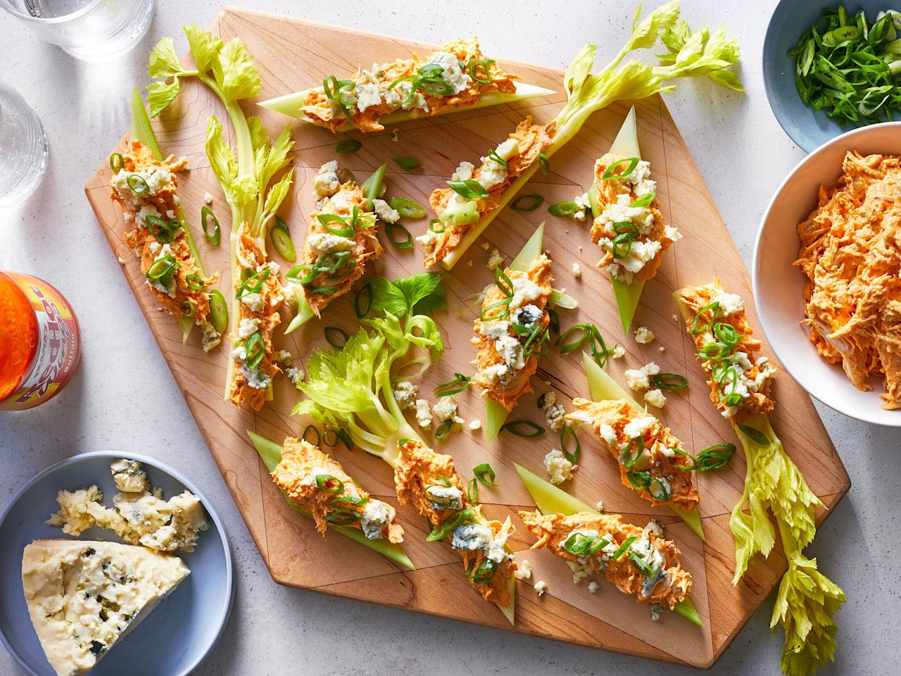 """<p>We can't decide what we love more about these Buffalo celery bites—the fact that they require zero cooking, come together in about 15 minutes, and are roughly the easiest appetizer ever OR the sheer magnitude of how delicious they are. But then, that's the beauty of these seriously upgraded stuffed celery sticks, you don't have to choose between convenience and full-on flavor. Crisp celery sticks are loaded with a creamy Buffalo chicken mixture—made entirely from store-bought staples—and topped off with crumbled blue cheese, making every bite the perfect Buffalo bite. Perfect for game day, these got-it-all snacks are sure to score more than a few devoted fans. </p> <p><a href=""""https://www.myrecipes.com/recipe/buffalo-chicken-stuffed-celery"""">Buffalo Chicken Stuffed Celery Recipe</a></p>"""