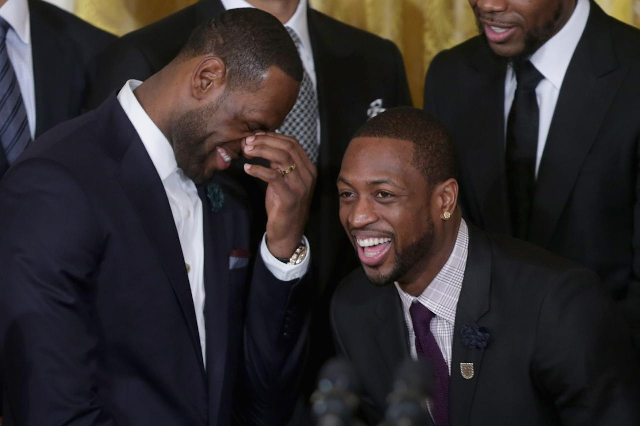 WASHINGTON, DC - JANUARY 14: National Basketball Association 2012-2013 champion Miami Heat players LeBron James and Dwyane Wade share a laugh during an event in the East Room of the White House January 14, 2014 in Washington, DC. This is the second year in a row the team won the championship and made a trip to 1600 Pennsylvania Avenue. (Photo by Chip Somodevilla/Getty Images)