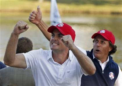 Keegan Bradley and Phil Mickelson celebrate after beating Rory McIlroy and Graeme McDowell. (Reuters)